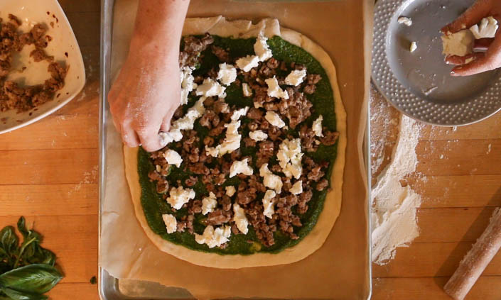 The Locavore Pizza – with Sausage, Goat Cheese, & Spinach Pesto