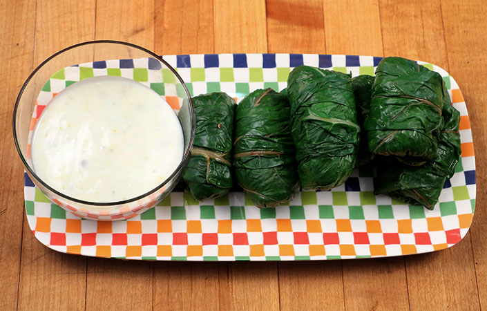Swiss Chard Rolls with Lemon Caper Yogurt Sauce