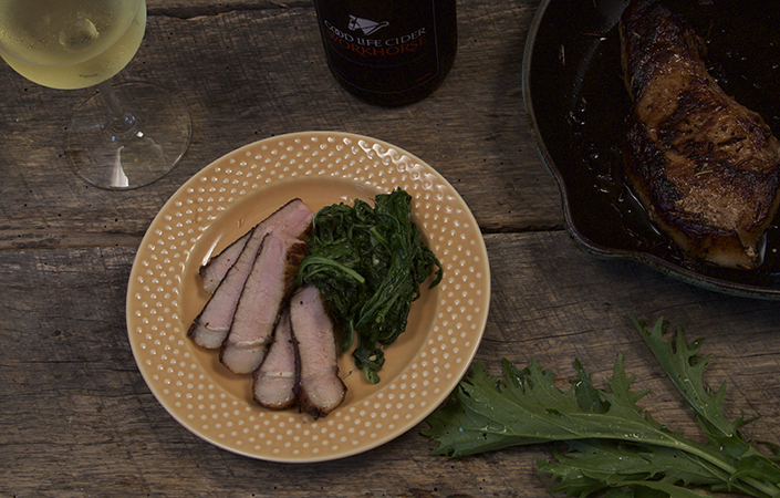 Cider Marinated Pork Chops with Wilted Greens